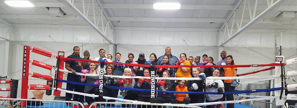 Instructors and participants take a break from practice at the 2015 Women's Boxing Challenge.